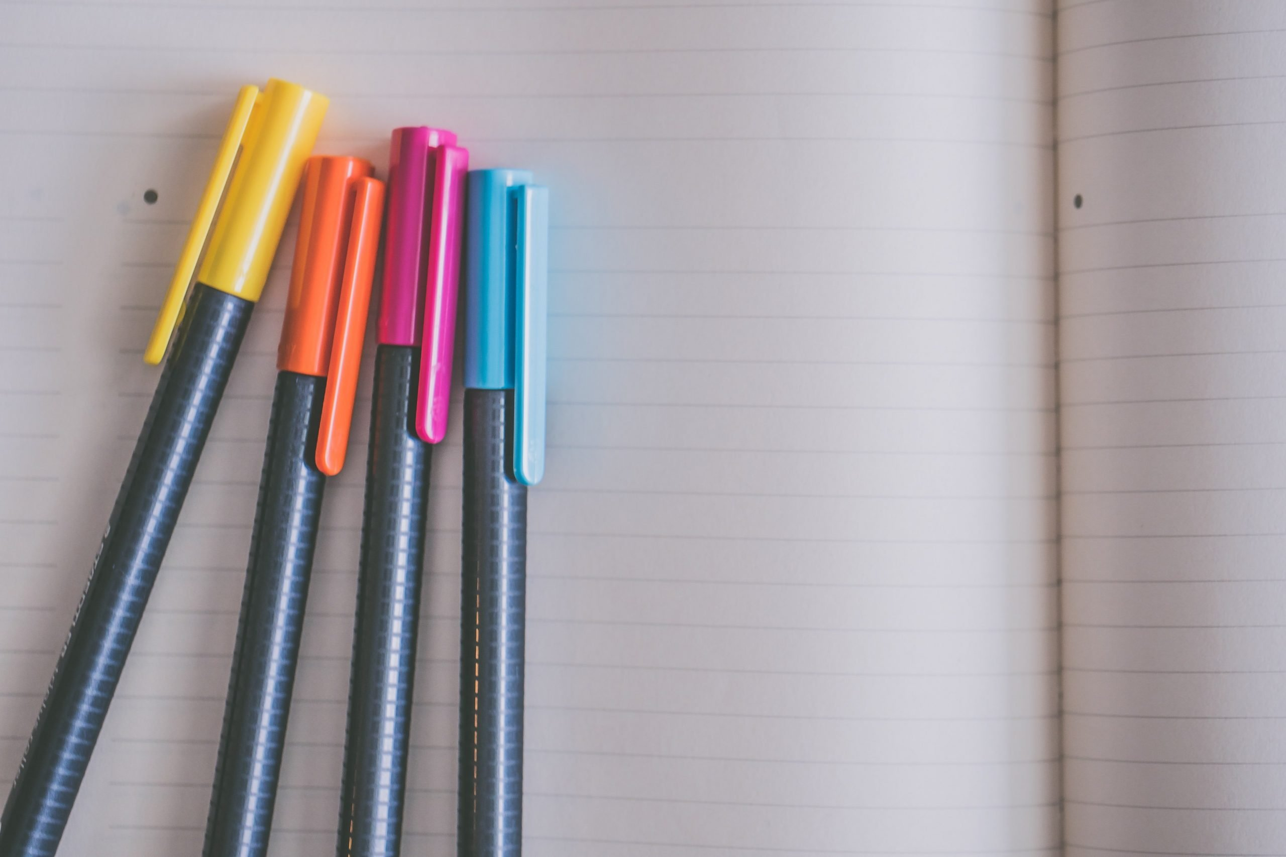 writing a letter with colorful pens