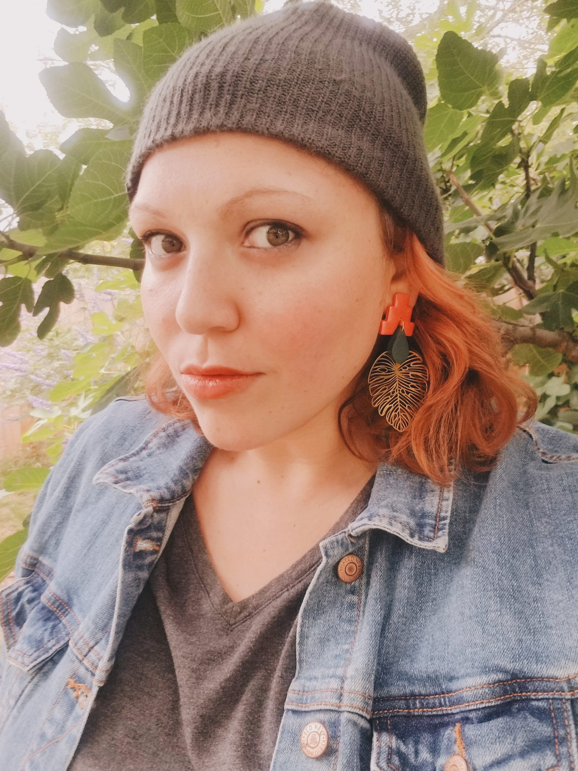 redhead woman in a grey beanie looking at the camera